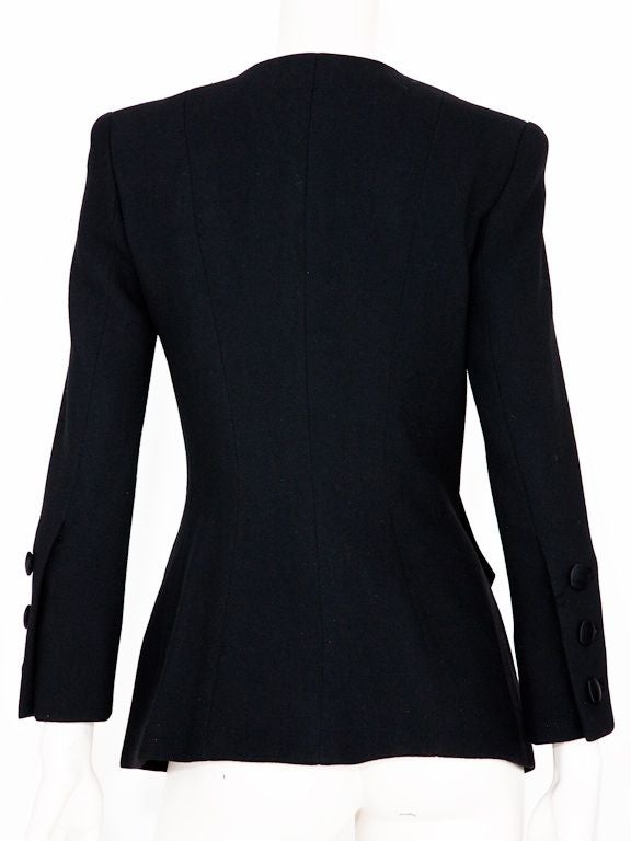 Black wool twill fitted Yves St.Laurent couture jacket with black braided passementerie, jet beading and tassels at hip.<br />