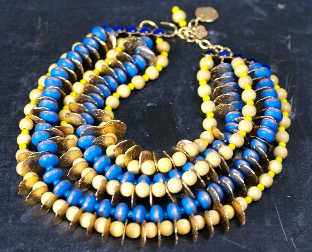 """Oversized YSL bib of unusual genius juxtaposition of dyed wood beads, gilt antique """"coin"""" spacers and glass strass stones. 3 rows of birch toned wood beads are mixed with yellow pate de verre beads and the coin spacers. Blue compostion gilded beads"""