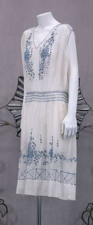 Charming Hungarian day dress in white cotton voile with deep cornflower blue embroidery, drawnwork and smocking. <br />