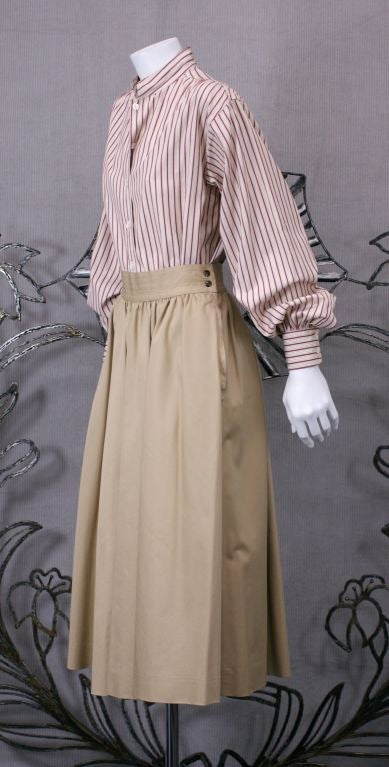 Simple and perfectly cut YSL Khaki cotton twill skirt with trapunto waist and snap closures. Full circle skirt is gathered at waist.   Side pockets in seams. 1970's France. Excellent condition.  Vintage size: 40<br /> Waist 26