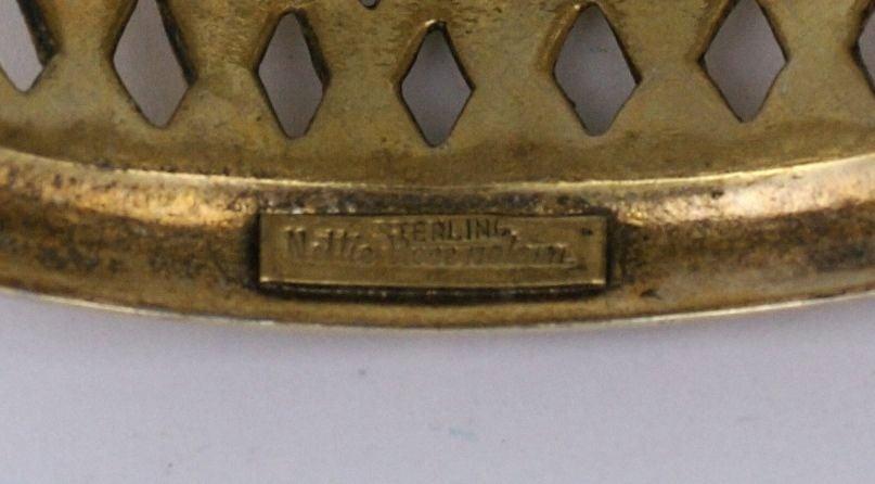 Nettie Rosenstein basketweave motif cuff in heavy gilt sterling circa 1940. Side tongue closure with safety chain. Interior diameter: 2 3/8' x 2 1/4' Width: 1 3/4