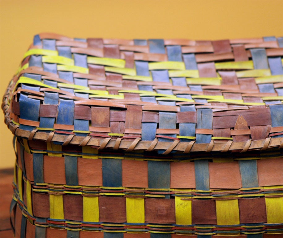 Exceptional rectangular storage basket decorated with vivid colors. Old paper lining (tattered from age.)