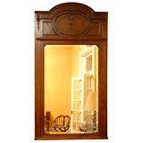 Antique English mahogany and amboyna wood inlaid mirror.