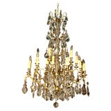 Antique French crystal and bronze Louis XV 20-light chandelier.