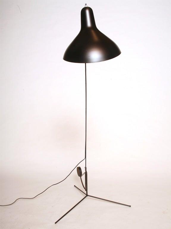 Great floor lamp with adjustable arm,<br /> black enameled metal frame  56