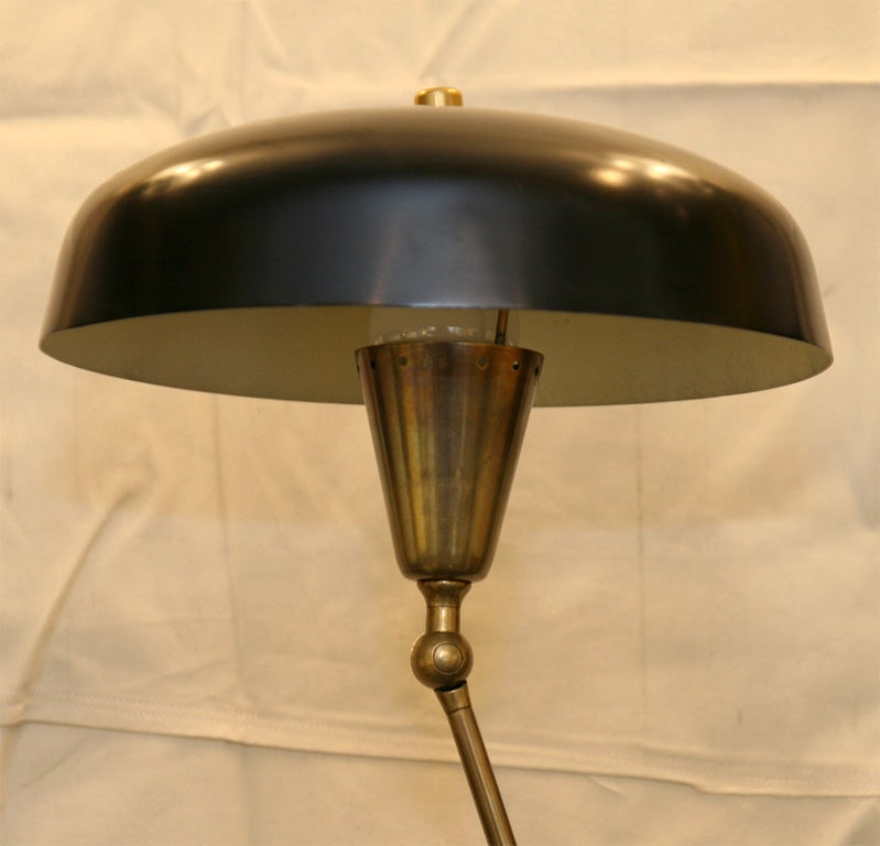 An Articulated Floor Lamp with unique adjustment by  Arredoluce 7