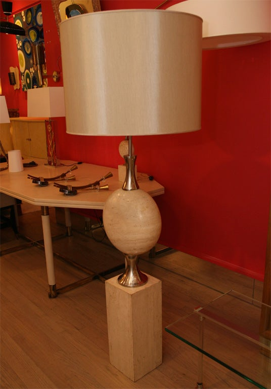 Stunning travertine floor lamp by Philippe Barbier, the travertine flattened sphere at it's center is solid stone accented by silver plated elements.