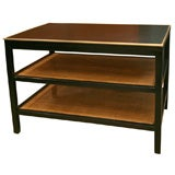 Paul McCobb ebonized side table with brass trim & caned shelves