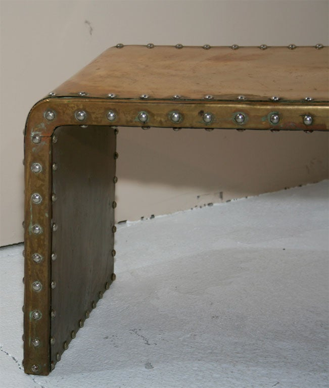 Studded brass waterfall cocktail table by sarreid ltd at for Coffee table with studs