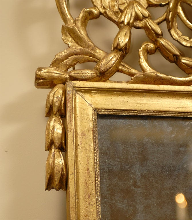 Late 18th Century Louis XVI Period Gilt-wood Mirror with Crest, France c. 1780 For Sale