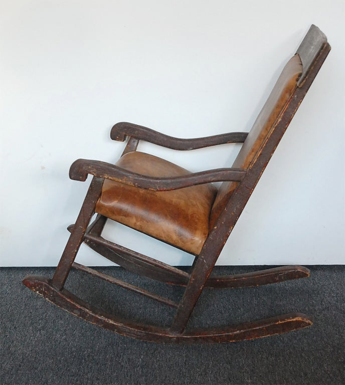 19THC ORIGINAL PAINTED BROWN ROCKING CHAIR W LEATHER SEAT