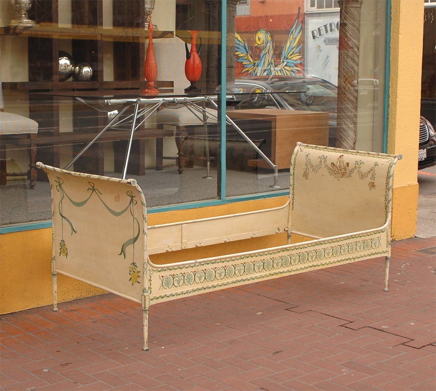 Sleigh-style steel campaign/daybed painted in the late 19th or early 20th century. The mattress size would be 74