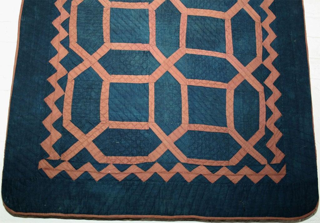 Geometric antique child's quilt. Mounted on stretcher.