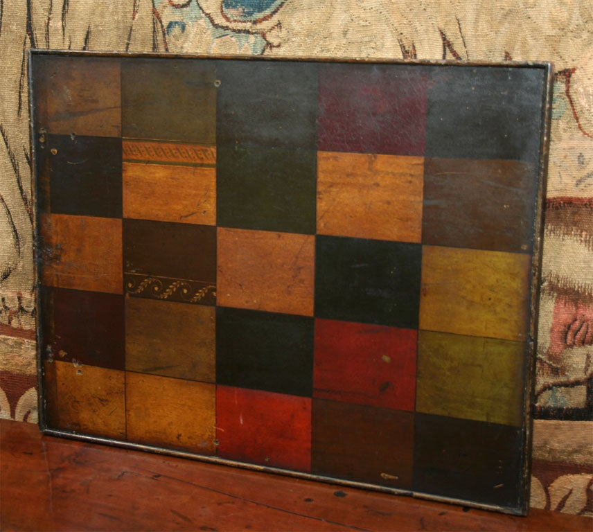 A Folk Art two-sided sign maker's sample board in original paint, one side having square color samples with various border treatments, each panel numbered (one through 25), the other side depicting a representative coat of arms showing eight