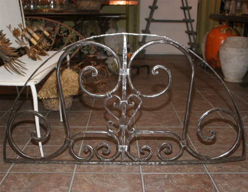 Beautiful vintage wrought iron door transom grill with newly brushed and polished surface.