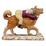 EnglishStaffordshire figure of boy riding a dog