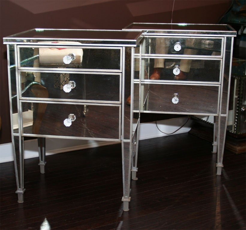 Pair of custom silver trim commodes with three drawers.