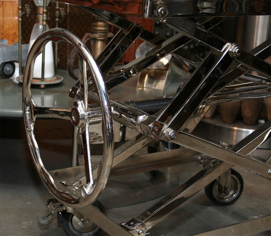 A beautifully thought out and well executed industrial design project. These steel lifts, in their time used for toting heavy machinery or engine blocks, are now Nickel plated and perfect for a kitchen island, table, bar, or anything else you can