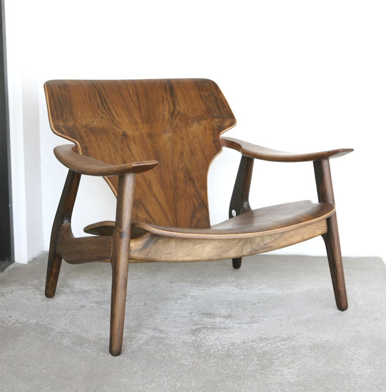 Solid hardwood frame with various oval section, Plywood molded seat and back, arms sculpted with anatomical shape.