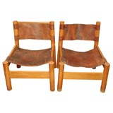 Pair of low oak and leather chairs in the style of Pierre Chapo