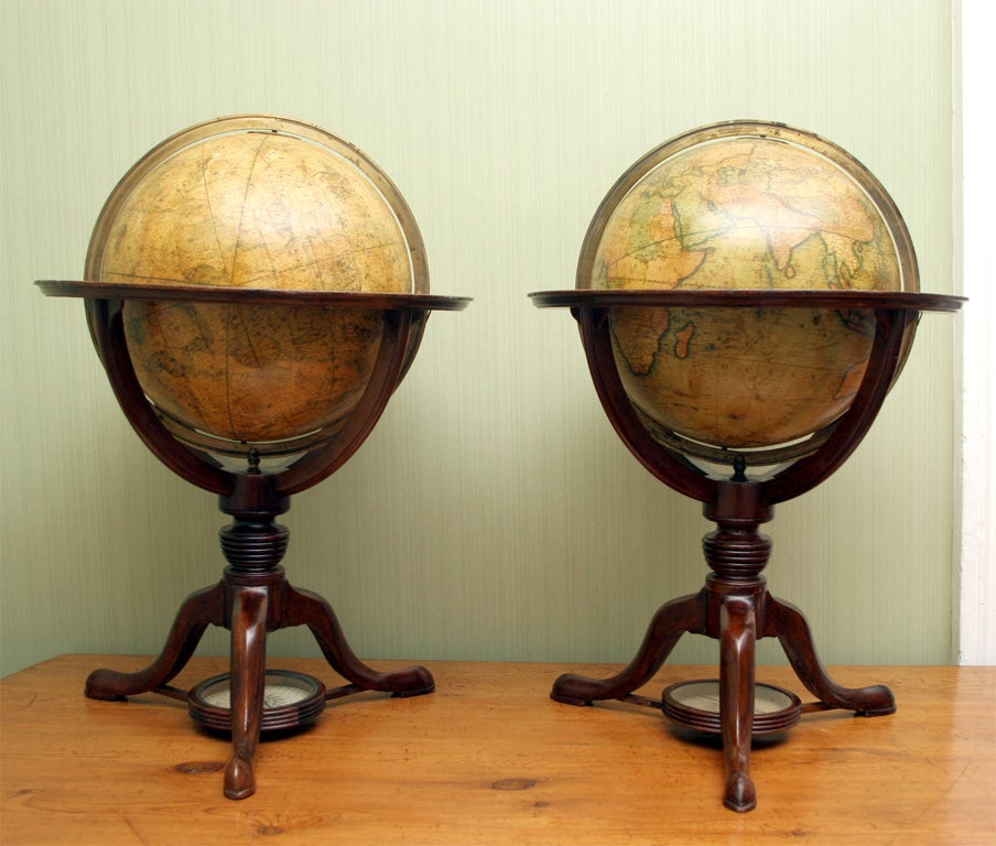 """Fine antique pair of table globes by Cary of London, each having a vertical brass engraved meridian ring held perpendicular to a horizontal wooden ring applies with zodiac scales, the terrestrial globe labeled """"Cary's New Terrestrial Globe"""