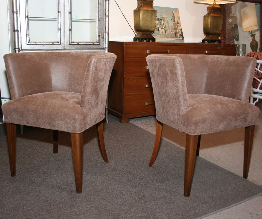 Midcentury tub chair. Covered in faux leather. Some wear.