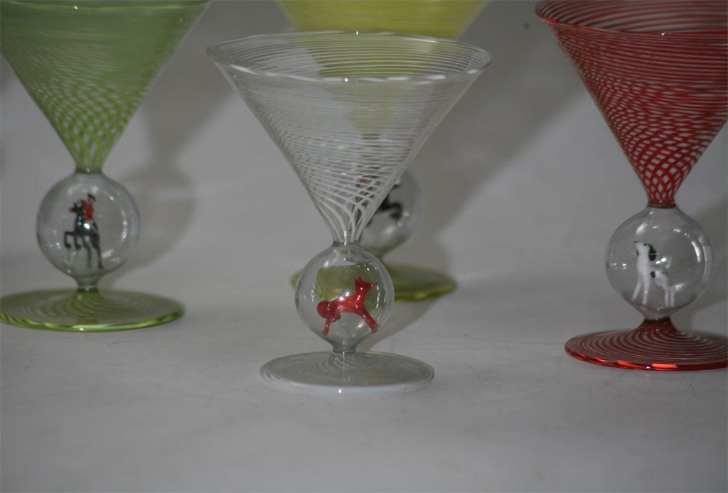 A rare set of 6 hand blown multi-colored martini glasses with figural hunt figures in the crystal ball connectors, including the elusive fox!