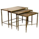 Nest of  3 Brass Tables with gold leaf glass tops