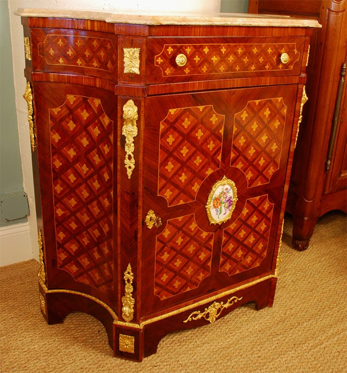 An elegant Louis XVI style cabinet (or