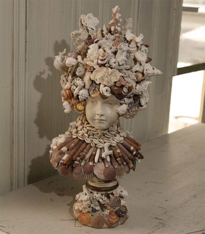 A tribute to the ocean is reflected in the classical vintage plaster bust adorned with seashells and coral.