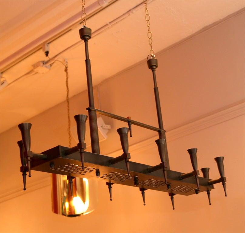 Elegant chandelier by Bagues, twelve lights with adjustable height.