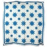 19TH C. BURSTING BLUE STARS QUILT FROM OHIO