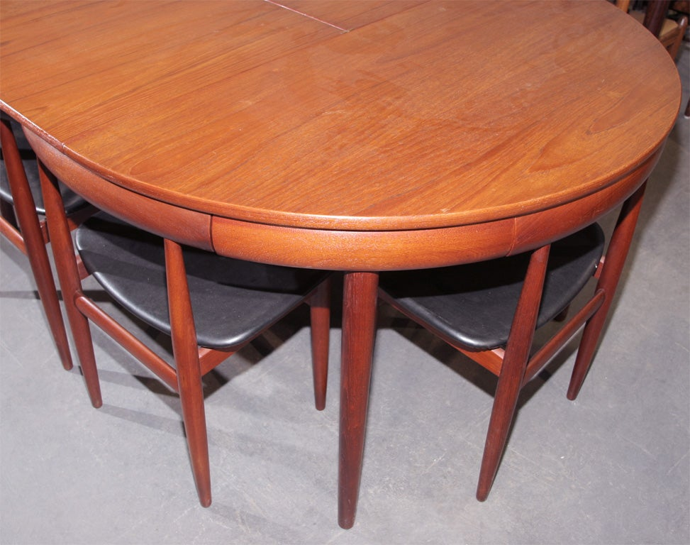 Teak dining table with nested chairs by hans olsen at stdibs
