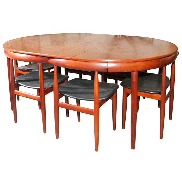 this teak dining table with nested chairs by hans olsen is no longer