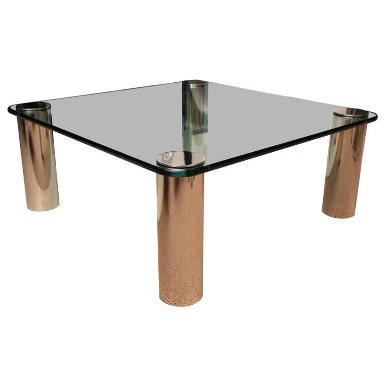 Square Glass Cocktail Table With Silvered Column Legs At