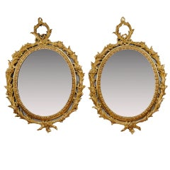 "Pair of George III ""Carton Pierre"" Oval Gilt Mirrors"