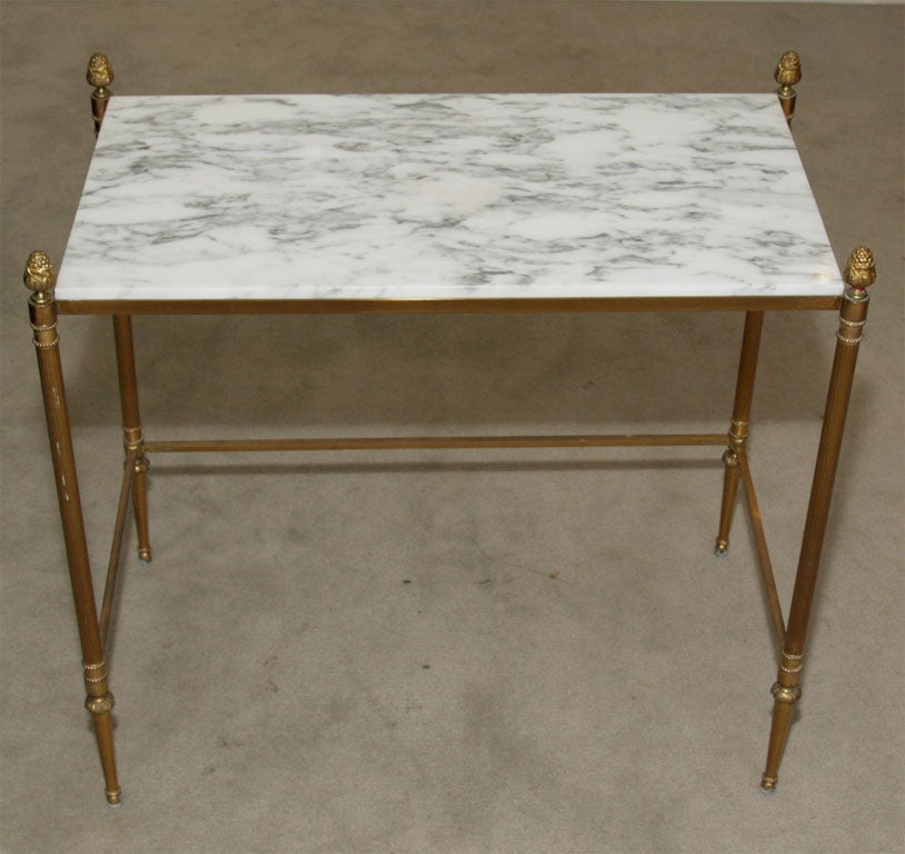 Gilt bronze nesting tables with carrera plateaux at 1stdibs for Table carrera