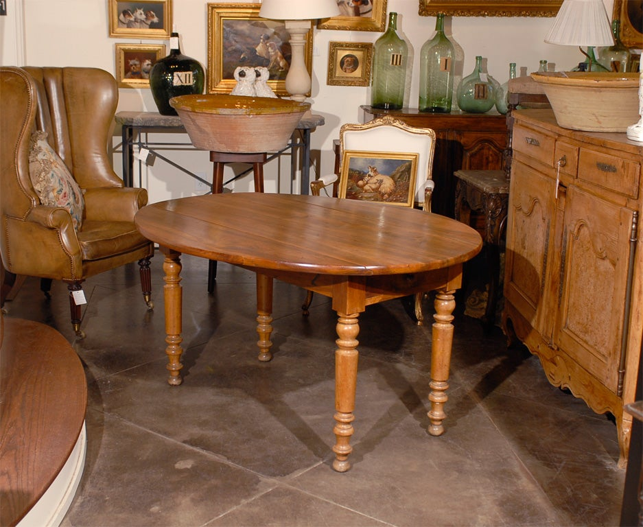 A French Walnut Oval Drop Leaf Table From The Late 19th Century With  Removable Top.