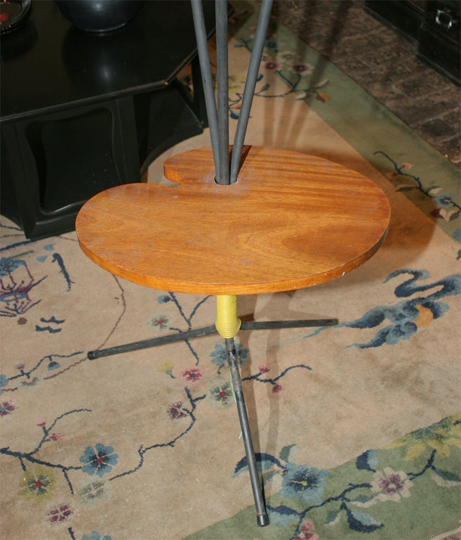 Charming painter's palette table with three paint brush lights.