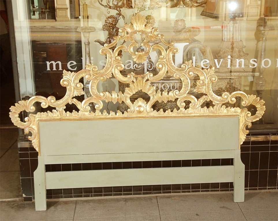 Carved Venetian giltwood headboard with scrolls & shells galore.  Imagine this piece upholstered to the floor!