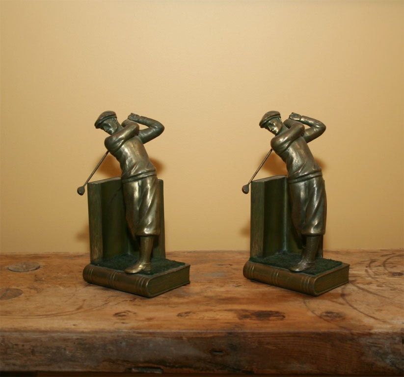 Pair of bookends golfers. Remarkable form. Detailed figures, each standing on a book.
