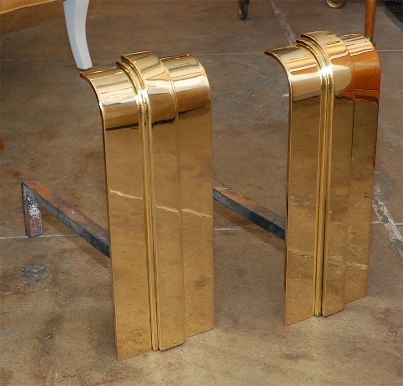 Pair of Art Deco style Brass andirons by Karl Springer.