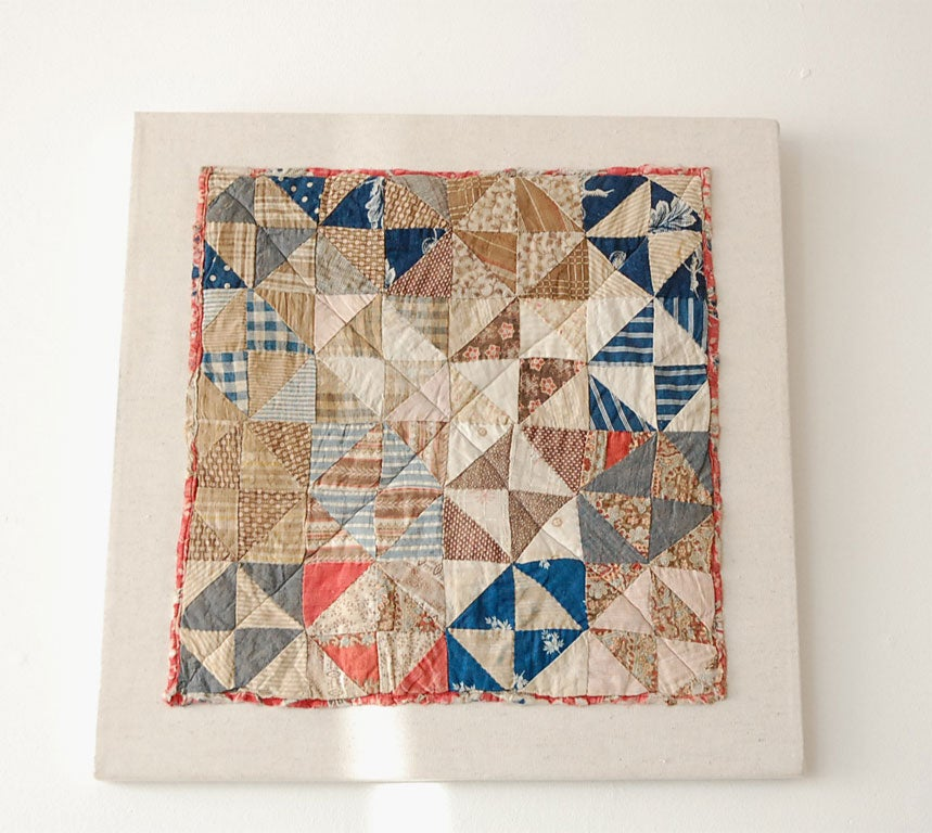 19TH C. BROKEN DISHES CHILD'S DOLL COTTON QUILT WITH A PICTORIAL CHINTZ BACKING. PROFESSIONALLY MOUNTED.