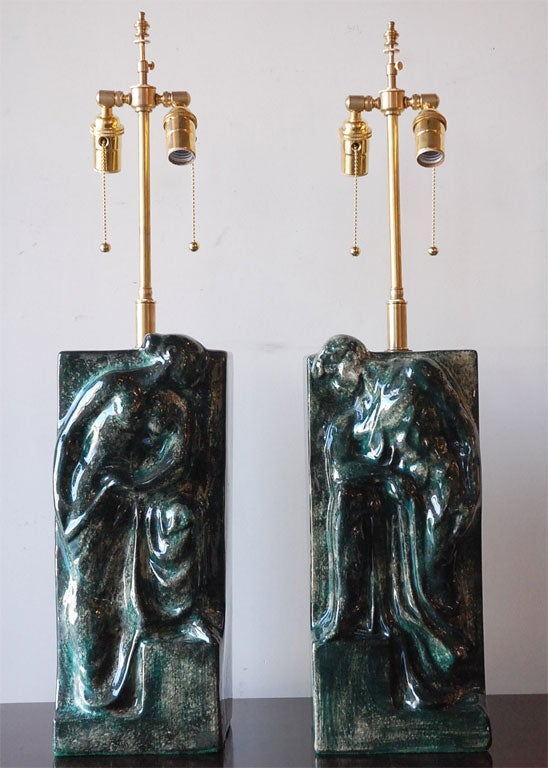 Classically inspired glazed ceramic table lamps with male and female figures. Total height of lamp top of finial is 32 H, the lamps are approximately 17.5 inches high. Excellent vintage, new electrical and hardware.