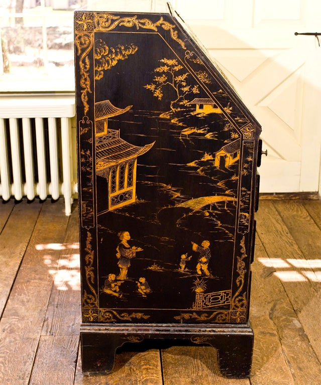 A Rhode Island tiger maple slant-front secretary, dated on its bottom board; with<br /> Japanning to the Boston taste executed 2nd quarter of the 19th century.  Seven<br /> small drawers, four pigeon holes, and a locking door in the upper case;
