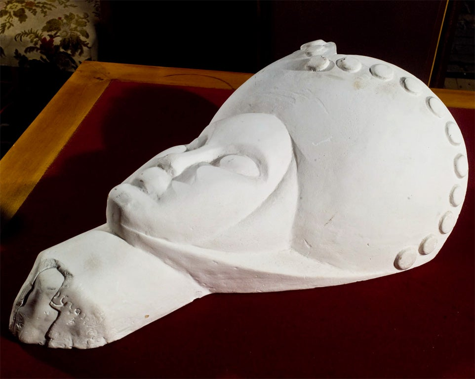 Fanciful plaster head with pocket.