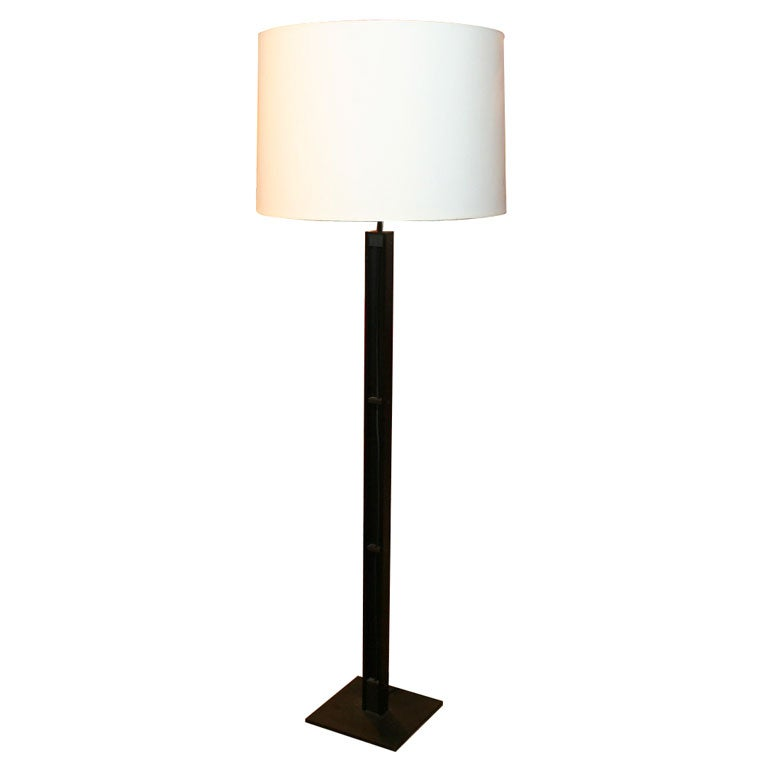 Tall dark and handsome floor lamp by christian liagre for sale