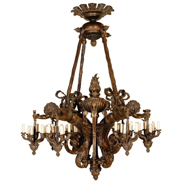 Wood and bronze chandelier with cherubs at 1stdibs