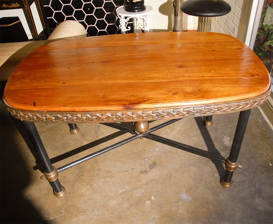 Iron and wood dining table at stdibs