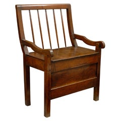 19th Century English Chestnut Comb Back Chair with Curved Arms and Long Apron